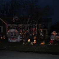 The Roark family's home in Cabin John features dozens of holiday decorations that cover the entire lawn. They started putting up lights ten years ag,o and the display has expanded each year. Photo by Chris Hoogstraten.