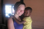 Junior Ali Foreman holds a local South African child during a visit to a township. Foreman spent six weeks in South Africa as part of an exchange trip. Photo courtesy Ali Foreman.