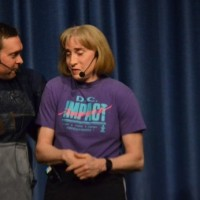 Self-defense expert Carol Middleton performs a roleplay with her assistant. She emphasized that listening to your instincts can save your life. Photo by Abigail Cutler.