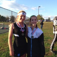 Emily and Miranda Tompkins pose with their medals. They took home ___Photo courtesy Olivia Tompkins.