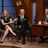 """Actress Amy Poehler and Vice President Joe Biden appear with host Seth Meyers on the premiere of """"Late Night with Seth Meyers"""" on Monday, Feb. 24, 2014, in New York. (AP Photo/NBC, Peter Kramer)"""