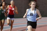 Junior Clare Severe pulls ahead of the competition the 800 meter run. Severe would go on to win the event. Photo courtesy of Bill Ryan/The Gazette.