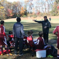 Matt Arrington ('06) works with a group of soccer players enrolled in Arrington Training & Development, a training academy he started with former teammate Dennis Schardt.  Arrington also coaches the JV boys soccer team along with Schardt.  Photo courtesy Matt Arrington.