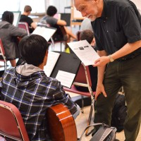Music teacher Wayne Chadwick helps a student with guitar.  Chadwick also teaches music theory, piano and electronic music at Whitman, and will retire this year.  Photo by Nick Anderson.