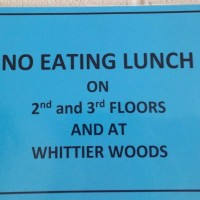 Surely everybody has seen the blue signs plastered all over the school, sheets of paper hung up intermittently every ten feet supposedly telling us to not eat on the second or third hallways during lunch. However, that's not exactly what they say. Photo by Sebastian van Bastelaer.