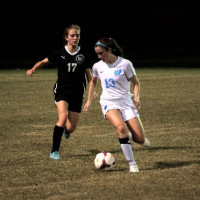 Wing Clare Severe dribbles the ball past a Wildcat player in the Sectional Semifinals Tuesday. Photo courtesy Michelle Jarcho.