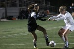 Forward Abby Meyers fakes out a Raider defender in the state semi-final Friday.