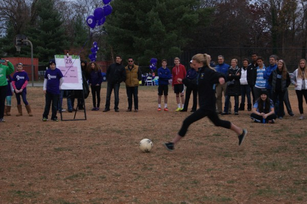 Freshman Lauren Meyer takes a shot in the pancreatic cancer shoot out last Sunday. Photo courtesy Arielle Grill.