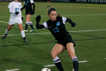 Wing Clare Severe saves the ball before rolling out. Photo by Nick Anderson.