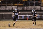 Kicker Jonah Brain (54) and quarterback Alex Hilsenrath (7) prepare to kickoff against the Blair Blazers. Photo courtesy Chris Hanessian.