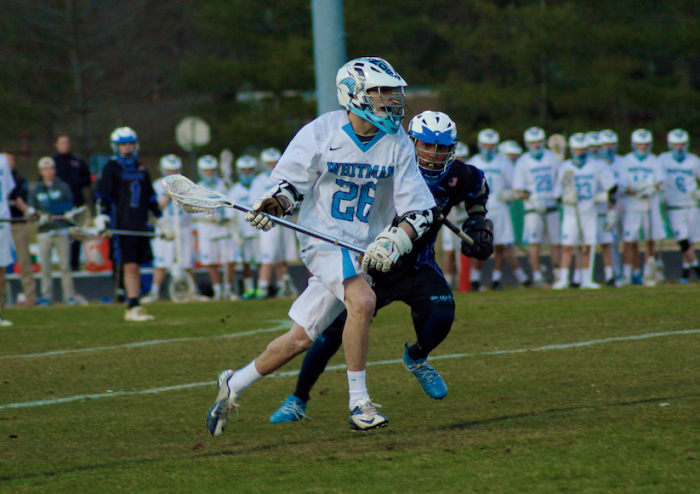 Midfielder Alex Hilsenrath (26) looks to a escape a Blake defender in the Vikings 15-6 win. Hilsenrath had two goals and two assists in the win. Photo by Nick Anderson.