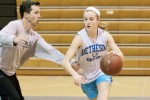 Sophomore guard Abby Meyers drives to basket against head coach Peter Kenah in a practice earlier this season. Both Meyers and Kenah received All-Gazette honors this past Wednesday. Photo courtesy The Gazette.