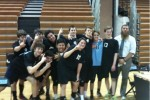 The boys volleyball team celebrates their first win in over three years. Photo by Carolyn Price.