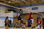 Outside hitter Riley Shaver goes up for a spike against the Patriots. Photo courtesy Chris Hanessian.