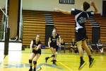 Outside hitter Riley Shaver goes up for a spike against Springbrook. Photo by Jordan Schnitzer.