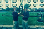 Will and Sam Arnesen (pictured left and right respectively) hoist their first place trophy after winning the Tournament of Champions at the University of Kentucky. The Arnesens also won the tournament last year, when they were co-champions with another Whitman team. Photo courtesy Will Arnesen.