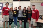Seniors in the Leadership class show off their shirts on college t-shirt day. Photo by Rachel Hazan.