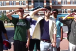 Senior Guilan Massoud, along with several other Whitman students, salute the camera in the Moco Cyper video. Photo courtesy of Andrew and Ramone Messam.