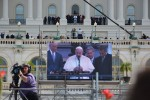 The Pope's words are broadcasted on a jumbotron as he addressed the thousands of people who came to see him this week in D.C. Photo by Grace O'Leary.