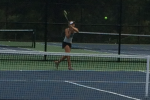 First singles player Carina Greenberg nails a backhand during practice. Photo by Ezra Pine