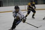 Defenseman Tiger Bjornlund heads down the ice in Friday's game against Richard Montgomery. Photo courtesy Tammy Hughes.