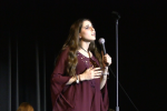 "Whitman idol Stefanie Abramowitz performs in the opening song in Whitman idol. Abramowitz won after singing ""Feeling Good"" by Nina Simone."