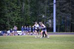 Midfielder Eden Gray fights for possession of the ball against an Urbana defender. Gray scored two goals in the team's win on senior night. Photo by Valerie Myers.