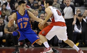 Knicks guard Jeremy Lin defends Raptors quard Jose Calderdon. Lin's rise from bench player to NBA superstar in a matter of weeks has fueled a media craze. Photo from JewishJournal.com.