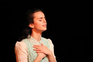 """NYU graduate Arielle Goldman performs """"To Life, L'Chaim!"""" The play, based entirely on Lowy's experiences in the Holocaust, was performed at CESJDS April 26. Photo courtesy David Stein."""